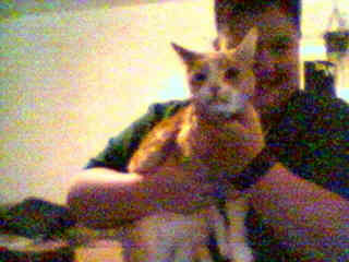 This is a picture of me and my cat, Peter.  He's not too keen on getting his photo taken.  On May 25, 2003, we had to put Peter to sleep.  He was 11 years old.  RIP Peter, you will be missed.