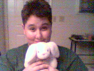 This is a picture of me and my stuffed bunny, Mr. Ears