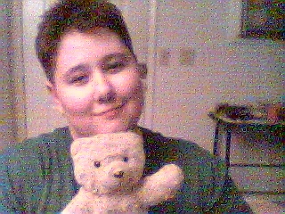 This is a picture of me and my teddy bear, BG.  I named him after the friend who gave him to me a long time ago, when we first met.