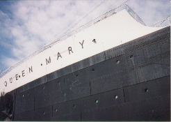 A photo taken of the bow of the ship (hotel) that still has all of the markings on her as if she was still in service on the seas